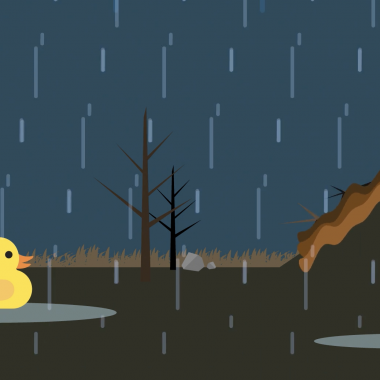 A picture of a rubber duck sitting in a puddle as it rains.